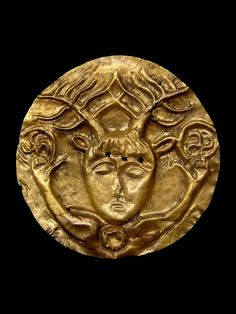 """Celtic Gold Phalera with Cernunnos, 1st Century BC Cernunnos is the conventional name given in Celtic studies to depictions of the """"horned god"""" of Celtic polytheism. The name itself is only attested once, on the 1st-century Pillar of the Boatmen, but depictions of a horned or antlered figure, often seated cross-legged and often associated with animals and holding or wearing torcs, are known from other instances."""