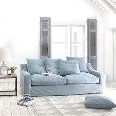 """CLOUD SOFA with removable cover. How comfy is this sofa? The clue is in the name. We like the way the back cushions are of differing sizes and have """"box edges"""" as it lifts the whole feel to a classy, laid-back level. #sofa #removablecover #livingroom"""