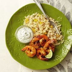 Grilled Curried Shrimp With Mango Couscous  Ingredients: whole wheat couscous, mango, jalapeno pepper, lime juice, cilantro, salt, pepper, red curry paste, vegetable oil, garlic, shrimp, Greek yogurt, ginger, lime wedge