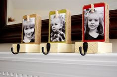 DIY stocking holders. Love the clothespin idea so the picture can be switched out each year.