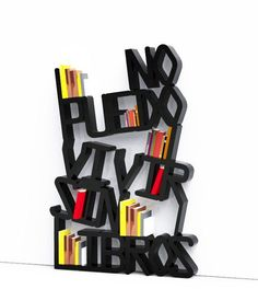 """Here it is a mixture of typography and form which appears to say in Spanish """"no puedo libros Vivir sin"""" which means """"I can not live without books""""."""