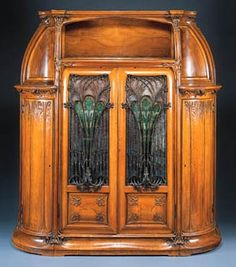 ❤ -'AUX ALGUES', A CARVED MAHOGANY, CAMEO GLASS AND WROUGHT-IRON CABINET  LOUIS MAJORELLE, CIRCA 1906