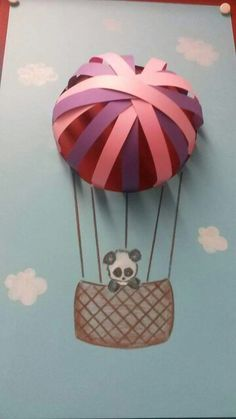 3-d air balloon project. Cut a hole in the paper, and glue construction paper to make the hot air balloon
