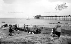 #Hunstanton, The Pier 1921. The #pier at this popular seaside resort was swept away in gales during the 1970s. Because of its situation on the Wash, Hunstanton is the only east coast resort where you can watch the sun set over the sea!