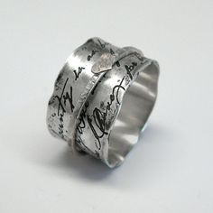 "WANT!!!!!  Juliet Spinner Ring in Sterling Silver with Sterling, Copper or Brass Spinner This ring's design is like a an old love letter. It is based on a phrase from William Shakespeare's ""Romeo and Juliet"":  My bounty is as boundless as the sea, My love as deep; the more I give to thee, The more I have, for both are infinite."