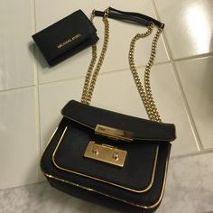 FLASHSALE TONIGHT ONLY Black and gold purse with matching wallet (authentic) Michael Kors Bags Shoulder Bags