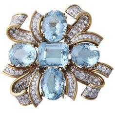 TIFFANY  CO SHLUMBERGER Diamond, Gold, and Aquamarine Brooch. Circa 1959.