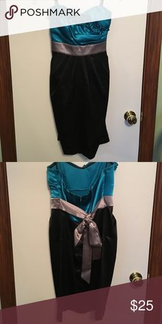 Blue, Black, and Silver Cocktail Dress Strapless cocktail dress with floral pattern. Has pockets for unique style! Zips and ties in back. Worn for homecoming but could wear for any special occasion! Byer California Dresses Strapless