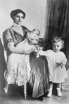 And then there were two.  Archduchess, later Empress, Zita with her first 2 children:  curly haired firstborn Archduke Otto and newborn Archduchess Adelheid.
