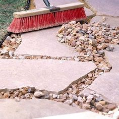 Simple Easy shares a story of how a handy homeowner designed and built a large flagstone patio with irregularly shaped stones. Simple Easy shares a story of how a handy homeowner designed and built a large flagstone patio with irregularly shaped stones. Flagstone Pavers, Paver Walkway, Rock Walkway, Gravel Pathway, Pebble Walkway Pathways, Patio With Pavers, Pebble Driveway, Pebble Patio, Slate Walkway