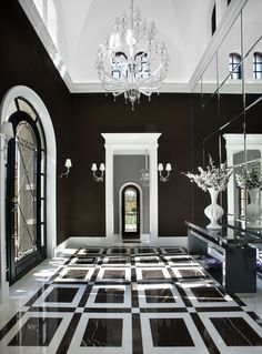 This mesmerizing black and white hallway was completed by Salcito Custom Homes. #luxeAZ