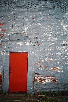 red door grey wall by Luke Elsasser, via Flickr