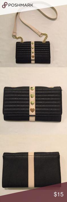 Betsey Johnson Black/Cream Crossbody Betsey Johnson black/cream crossbody features gold tone hardware, removable strap, flap closure,  inner pocket, 8 credit card slots, inner zip pocket. Betsey Johnson Bags Crossbody Bags