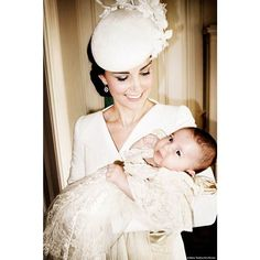 The Duchess of Cambridge holds Princess Charlotte in the Drawing Room at Sandringham House