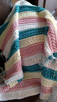 Creative and colorful crochet afghan patterns make lovely additions to any home. Made using a simple method, this Arrow Stitch Crochet Afghan Pattern works up quickly and easily, and is a great project for a beginner crocheter. Crochet Afghans, Easy Crochet Blanket, Crochet Blanket Patterns, Crochet Baby, Crochet Blankets, Baby Afghans, Baby Blankets, Baby Afghan Patterns, Crochet Quilt