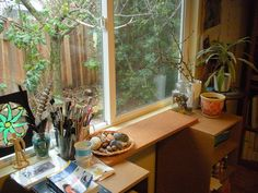 I love the idea of setting up art materials by a window what a great provacation to come and paint