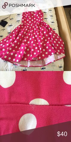 Sale ❗️❗️❗️Cupcake Traveling polka dot pink Dress Like new condition with a small snag as seen on the second picture but not really noticeable. The dress is like a magenta color with with polka dots. Cheaper on mercari! Has no other flaws like unwanted markings or stains. ModCloth Dresses