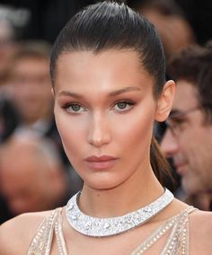 Bella Hamid's Cannes Film Festival makeup look with a glowing soft contour, matte smokey eye and a natural nude lip