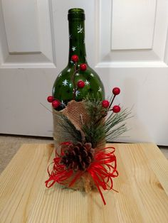The most beautiful 30 Christmas crafts decoration bottles ideas Glass Bottle Crafts, Wine Bottle Art, Diy Bottle, Glass Bottles, Bottle Centerpieces, Christmas Wine Bottles, Holiday Crafts, Christmas Decorations, Wrapped Wine Bottles