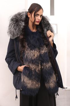 Parka with fox fur. Made in Italy; Color: blu and silver fox; Hood; Coulisse; Long sleeves with quilted lining and button fastening cuffs; Flapped front pockets; Internal drawstring waist and hem; Curved back hem, centre-back hem slit; Concealed zip centre-front fastening; Length: 85 cm; #parka #elsafur #fur #furs #furcoat #coat #mink #cappotto #peliccia #pellicce