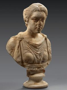 Pportrait of a Roman lady, probably a priestess wearing tunic and stola. Above the forehead a hole, probably for a crown or diadem. Base after the antique. Middle Antonine Period, about 160 - 180 A.D