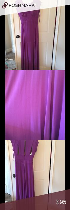 BCBG formal dress Beautiful purple/orchid color. Stretch makes it super flattering. There are two slits. Worn once to a military ball. Dry cleaned no stains or marks. One small pick which you can see in the picture is avout 1/3 from bottom of dress on the back. BCBG Dresses Maxi