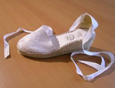 Hand-made women's espadrilles. White with embroidery. minus the heel