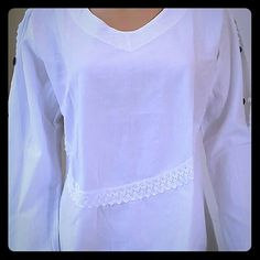Women's Top Crisp cotton  blouse gets a laid back summer makeover in this top. Has buttons on the sleeves and white crochet designs at the bottom. Pair it with anything from tailored shorts to distressed denim for a look that's as easy as it is chic.  100% Cotton 100 % Natural Tops Blouses