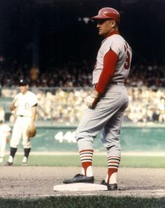 Outfielder Roger Maris of the St. Louis Cardinals rests at first base during the 1968 WS at Tiger Stadium in Detroit. St Louis Baseball, St Louis Cardinals Baseball, Baseball Star, Stl Cardinals, Baseball Players, Pirates Baseball, Baseball Cards, Mlb Uniforms, Baseball Uniforms