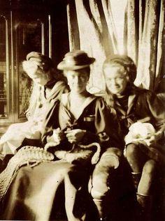 Alexandra crocheting with Tatiana and Olga.