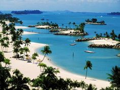 Sentosa Island, Singapore. Love the white sand beach, deep blue ocean and palm trees. I want to go there now!