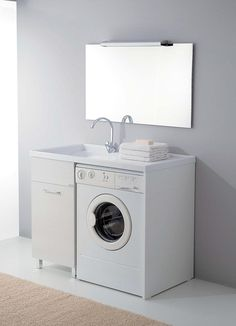 Simple Laundry Sink Design Above Table As Well Comfortable Washing Under Vanity Along With Elegant Mirror On The Wall And Beige Fur Rug On Floor Laundry Room Sink Designs for Stylish and Beautiful Laundry Rooms Interior Design
