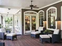 Beautiful southern porch. Screened in outdoor living with wall sconces and arched windows - Charleston, SC- LJKoike
