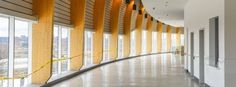 Centre Vidéotron_Québec 92 colonnes de bois d'épinette noire lamellé-collé, fabriquées par Nordic Structures Bois, ont été installées comme éléments de soutien des murs extérieurs pour supporter l'enveloppe extérieure de l'amphithéâtre Centre, Comme, Stairs, Home Decor, Walls, Wood Construction, Envelope, Stairway, Decoration Home