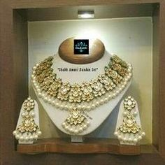 Finish- 22kt Gold Patra with Lamination (non tarnished) on Silver plus Alloy Green Enamelling on Side of Design and Beautiful colours Enamelling at Back side.. Stones:White High Quality Imitation Kundan stone fresh water Pearl and emerald jades peroi. Mea...