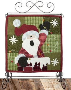 "Rooftop Santa Little Quilts Squared pattern by The Wooden Bear.  Pattern includes instructions for making a 12"" square quilt, or you can add the letter blocks and even an attachable quilted calendar holder.  On our website, you can print FREE monthly or weekly calendar pages that match the monthly quilt to use in the calendar holder."