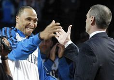 Shawn Marion, left, is greeted by coach Rick Carlisle before receiving his championship ring
