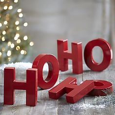 "Glossy bright red letters spell out a 3D ""ho, ho, ho"" for wall, mantel or tabletop."