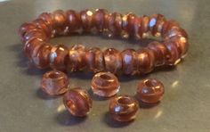Czech Small Roller Bead 6mm X 9mm Sunstone Copper Lined Qty 5 by gypsybeadpeddler on Etsy