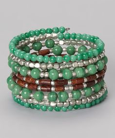 Casually chic and completely classy, this bracelet adds beauty to any ensemble. This elegant accessory features sleek strands of glass beads and coils easily over the wrist.