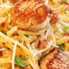 Carbonara with Pan Seared Scallops. Cream, salt, egg yolks, ground pepper, butter, pepper, thick-cut bacon, green onions, scallops, shallots, pasta, garlic, scallops, olive oil, parmigiano reggiano cheese.