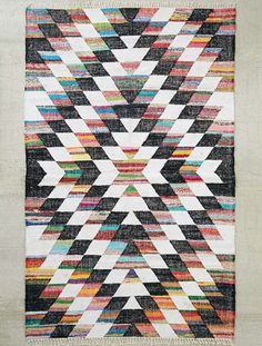 Woven in an allover diamond pattern, this kilim rug is the perfect statement piece to tie together your lounge area. Measures 5' x 8'.