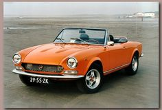 Lovely Fiat 124 Spider.  This should be a B-Series car, with a 1608cc engine.  The car was styled by Tom Tjaarda, an American, and the twin-cam engine was designed by Aurelio Lampredi, the man who designed some of Ferrari's earliest winning Grand Prix engines.