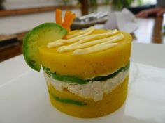 Causa is a unique Peruvian dish made of potatoes (shocker, I know) that are mashed and seasoned with key lime, onion, chili, and oil.  The mashed potatoes are then layered with a variety of stuffin…