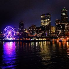 Admire the glowing #Seattle skyline while on the ferry ride to Bainbridge Island.    Photo courtesy of @ ireney128 via Instagram