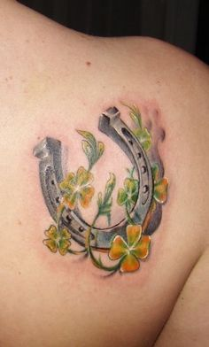 Yellow-and-green-flowers-with-horse-shoe-tattoo