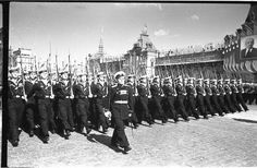 Soviet Navy officers and cadets of the Leningrad Higher Naval Engineering School marching through Red Square in the 1951 Moscow May Day Parade.