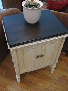 French distressed furniture look by refinishing using flat white paint and rubbed with brown shoe polish.