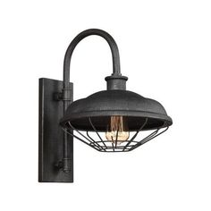 The Outdoor Wall Lantern by Feiss is a throwback to the Industrial Revolution, featuring open metal cages, exposed lamping and gooseneck detailing that resemble true vintage warehouse fixtures. Real gas piping secures the pitted, rugged sand-cast shades, which are produced in a new Slated Grey Metal finish. Visit PatioProductsUSA.com to purchase now! #outdoorlighting #patiolighting #porchlighting Outdoor Barn Lighting, Outdoor Wall Lantern, Porch Lighting, Outdoor Wall Sconce, Outdoor Walls, Wall Sconce Lighting, Indoor Outdoor, Wall Sconces, Vintage Lamps