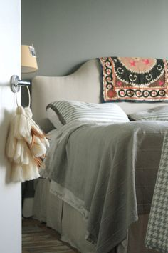 """Sneak Peek: Best of Gray. """"The entrance to jeweler Jennifer Sarkilahti's bedroom in Williamsburg, Brooklyn is adorned with a wool dreamcatcher that she made out of wool roving and feathers."""" #sneakpeek"""